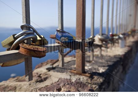 Oia,Santorini, GREECE - June 14, 2015:padlocks with love message left on the fence of the castle of Oia