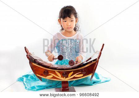 Beautiful young girl playing thai Xylophone or ranard