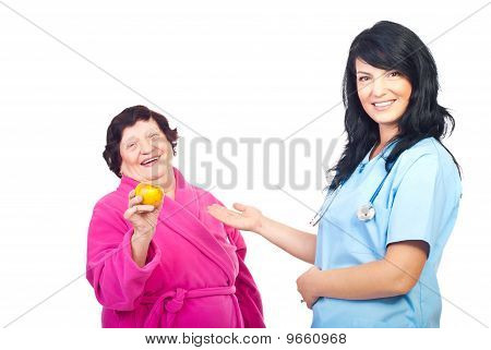 Friendly Doctor Showing To Healthy Patient