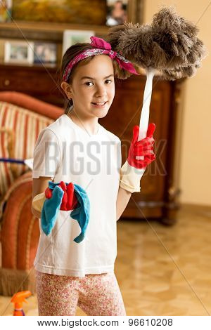 Teen Girl Cleaning Living Room With Cloth And Feather Brush