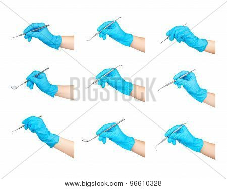 Collection Of Dental Instruments In The Hands Isolated On White Background