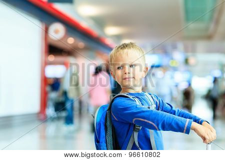 little boy with suitcase travel in the airport