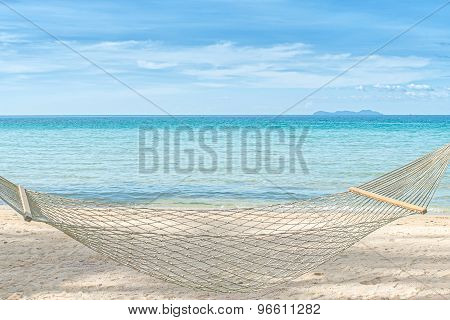 Summer, Travel, Vacation And Holiday Concept - Empty Hammock Between Palm Trees On Tropical Beach