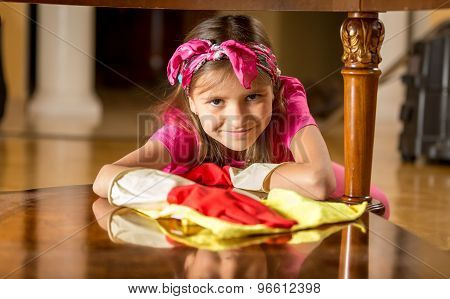 Smiling Girl In Rubber Gloves Cleaning Table By Rag