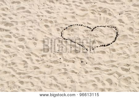 Heart Of Conifer Cones Inlaid On A Background Of Sand