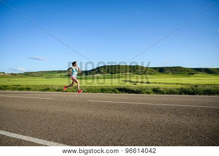 Woman Running On Countryside Road