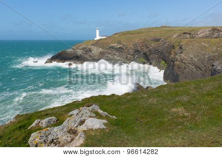 Lighthouse by rough sea North Cornwall coast between Newquay and Padstow English maritime building