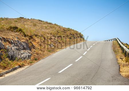 Empty Mountain Road And Blue Sky
