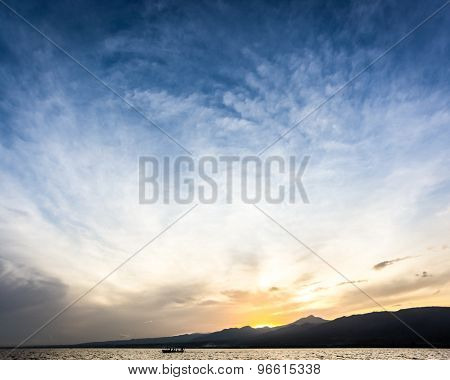Sunrise behind mountain and beautiful clouds