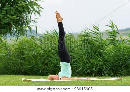 Yoga Pose In The Park Suppor Ted Shoulderstand
