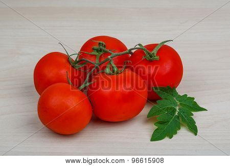 Tomatoes On The Branch
