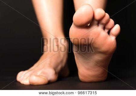 Foot Stapping Isolated On Black
