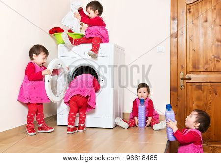 Smiling Cute Little Child Using Washing Machine At Home