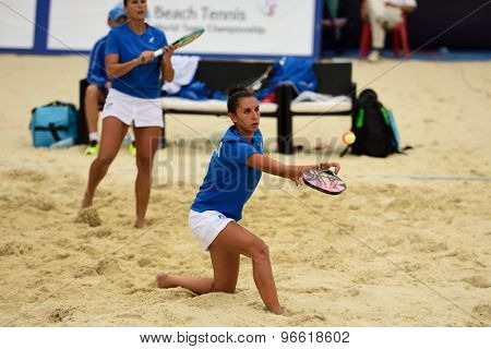 MOSCOW, RUSSIA - JULY 19, 2015: Sofia Cimatti (center) and Federica Bacchetta of Italy in the final match of the Beach Tennis World Team Championship against Russia. Italy become world champion