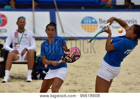 MOSCOW, RUSSIA - JULY 19, 2015: Sofia Cimatti (left) and Federica Bacchetta of Italy in the final match of the Beach Tennis World Team Championship against Russia. Italy become world champion
