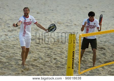 MOSCOW, RUSSIA - JULY 19, 2015: Sergey Kuptsov (left) and Nikita Burmakin of Russia celebrate the win in one match of final round of the Beach Tennis World Team Championship. Italy won the round