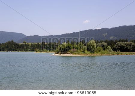 Lake Forggensee In The Bavarian Alps