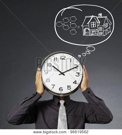 Businessman with alarm clock on head