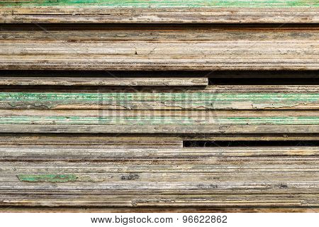 layers of timber with green paint