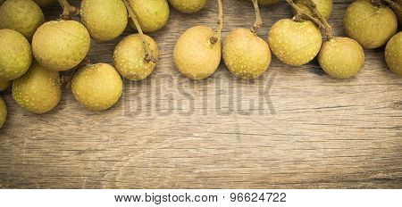 Longan On Wooden Background,tropical Fruit