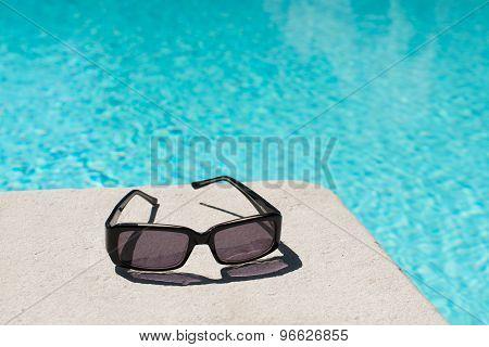Swimming Pool And Sunglasses