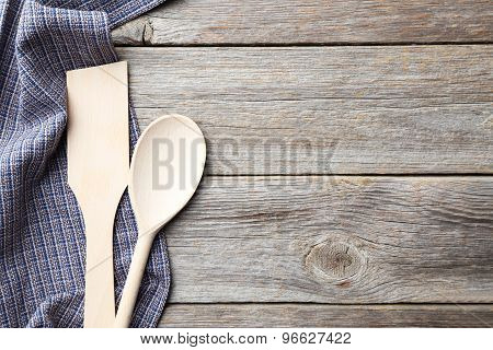 Empty Wooden Table With Wooden Spoon And Napkin On Grey Background
