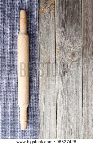 Empty Wooden Table With Rolling Pin And Napkin On Grey Background