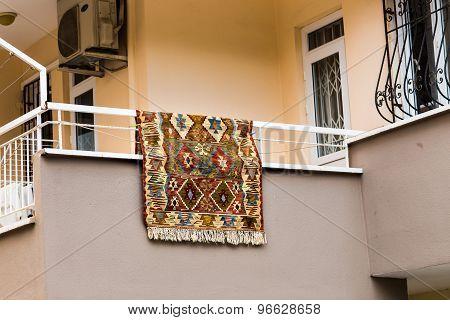 carpet   hanging on balcony