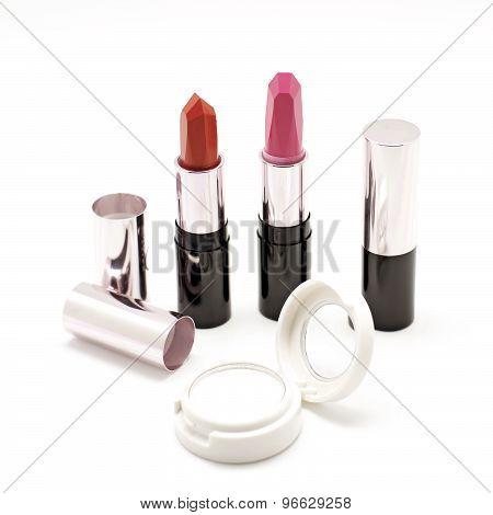 Lipstick And  Eyeshadow On White Background
