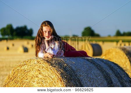 Teenage Girl With Long Hair Posing In Summer Field, Countryside