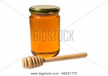 Jar With Honey And Wooden Spoon With Clipping Path