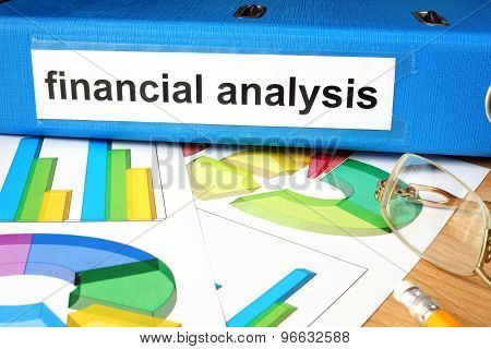 Folder with label financial analysis and charts.