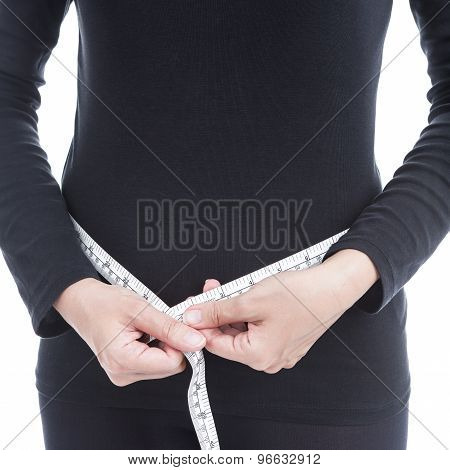 Healthcare And Diet Concept, Woman In Black Clothes Measuring Her Body On White Background.