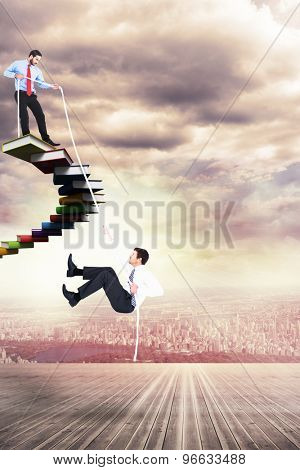 Businessman pulling a rope against balcony overlooking city