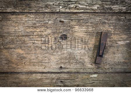 exclamation mark vintage letterpress printing block on rustic wood background, copy space at left side