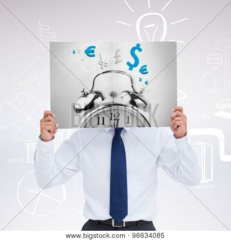 Tradesman holding blank sign in front of his head against grey background