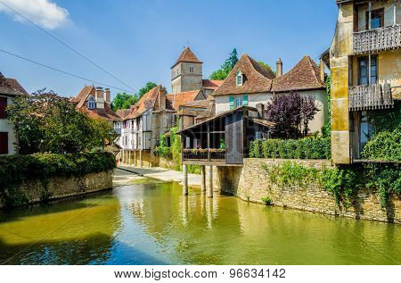 River and buildings in Salies de Bearn, France.