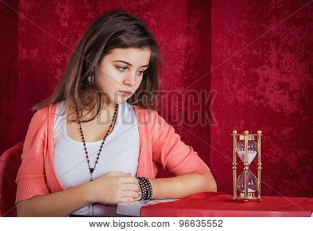 Teen girl with sandglass