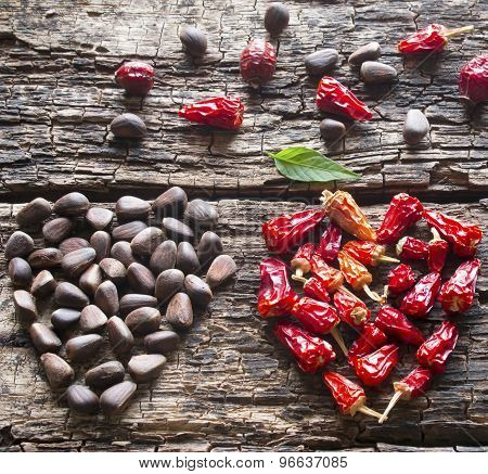 The Heart Of The Dry Red Pepper, Pine Nuts, Dogrose On A Wooden Background