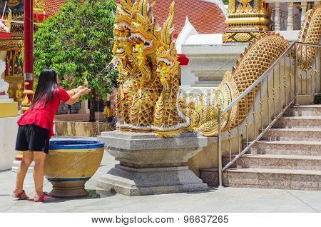 Women Worship Dragon Statue