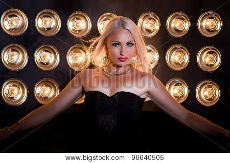 Beautiful Girl In Red Dress On Light Lamp Background
