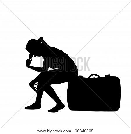 woman silhouette - sitting on luggage