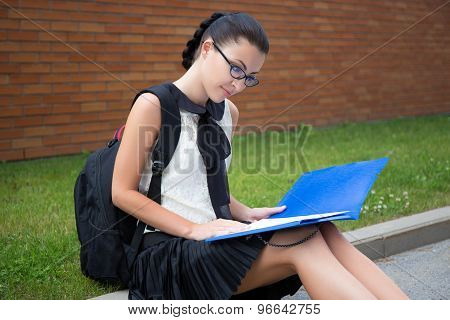 Education Concept - Beautiful School Girl Or Student Reading Something