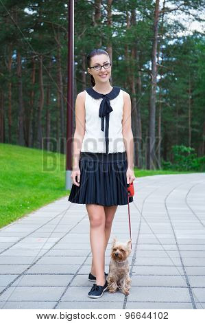 Happy Girl In School Uniform Walking With Dog