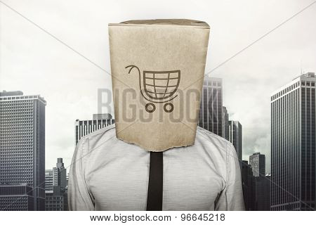 Shopping cart on brown paper bag which businessman has on head