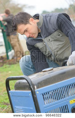 Builder turning on a mobile generator