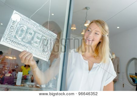 Female employee opening up the store