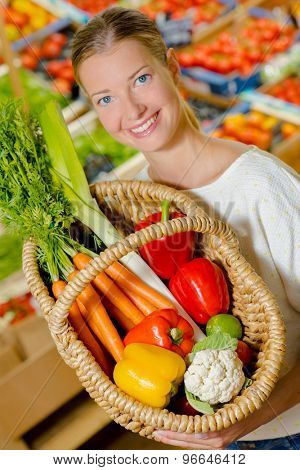 Woman holding up her shopping basket