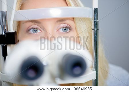 Blond woman having an eye exam