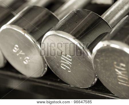 Rustic Steel Dumbells Closeup Vintage Tone